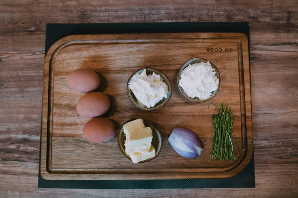 Ingredients needed to prepare this egg and cheese spread.