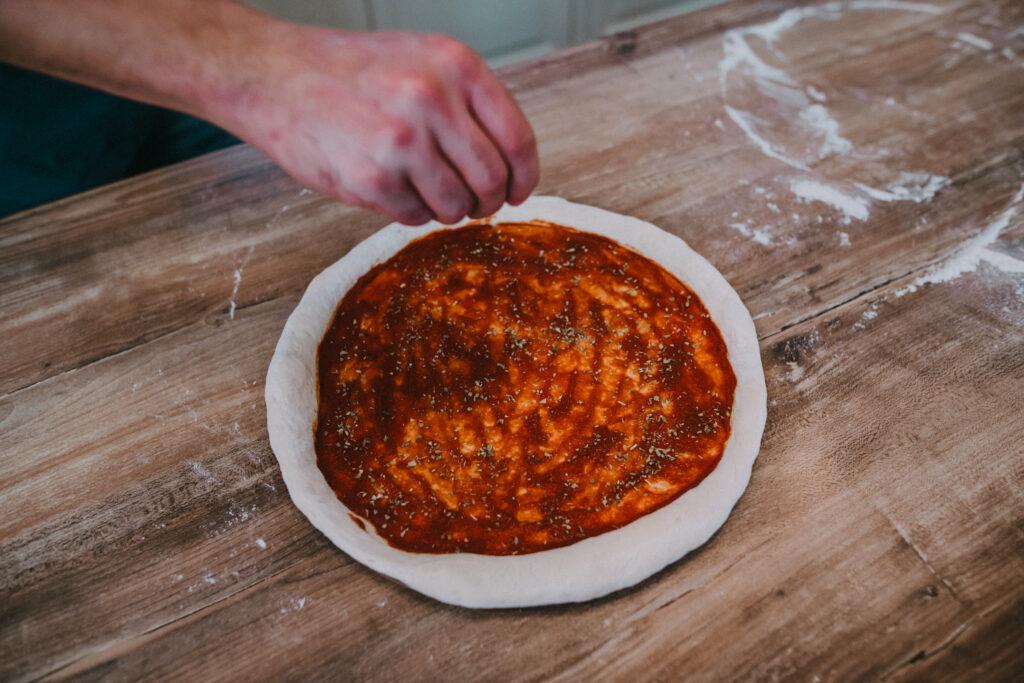 Start with tomato puree and dried oregano