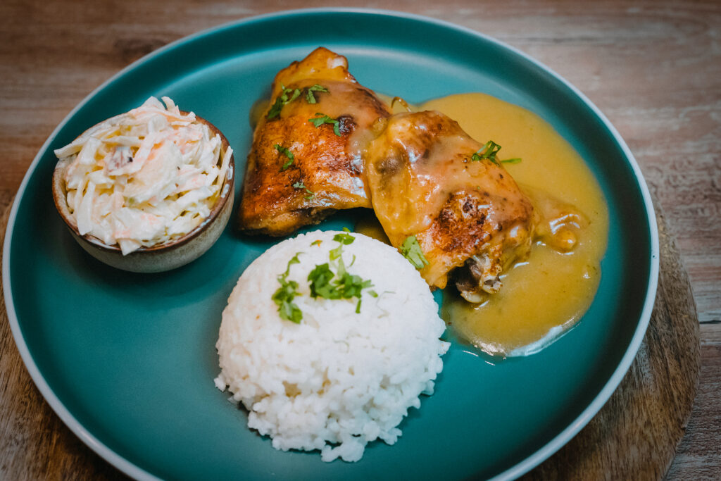 Simple oven baked chicken thighs with onion gravy.