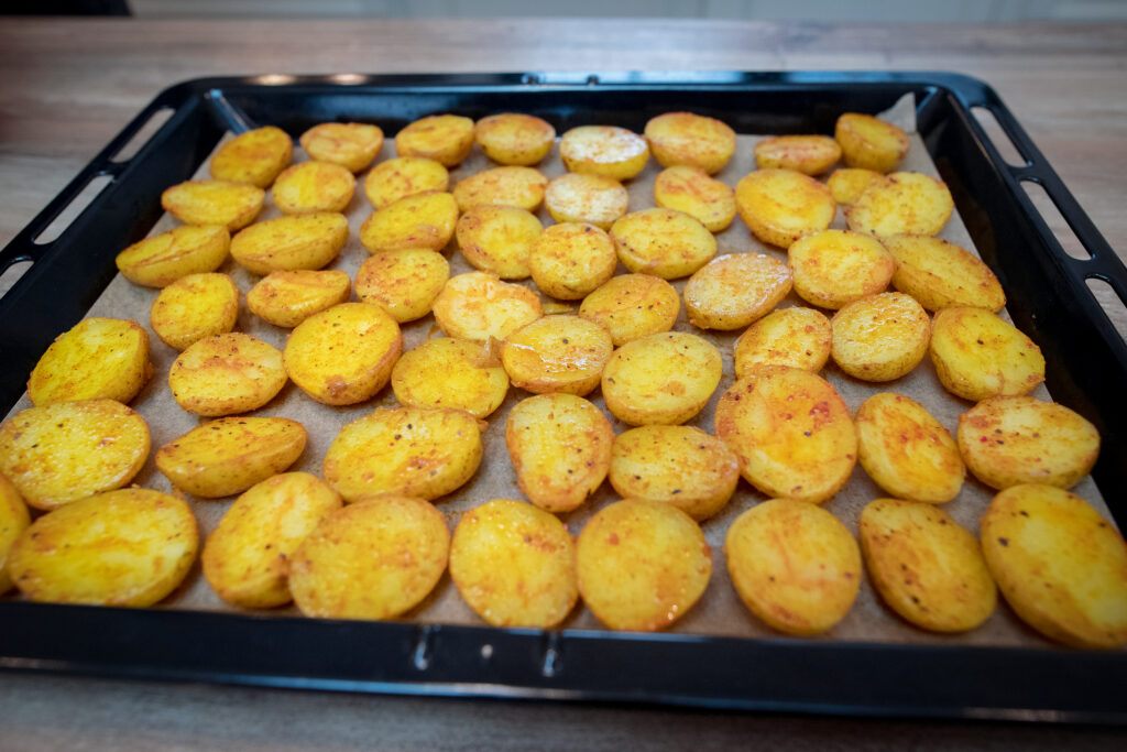 Place the potatoes on a baking sheet, skin side down.