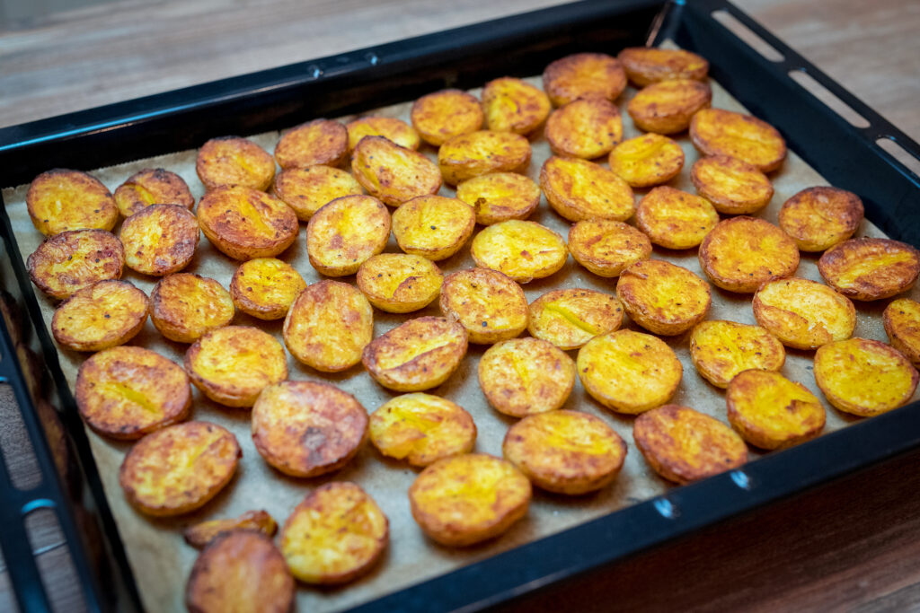 Finished oven baked potato halves.
