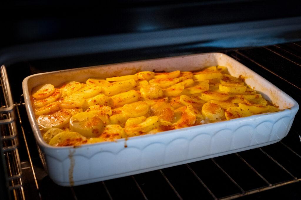 Potato casserole in the oven.