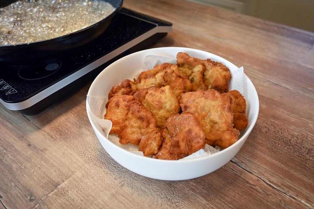 Golden brown pork schnitzels ready to serve.