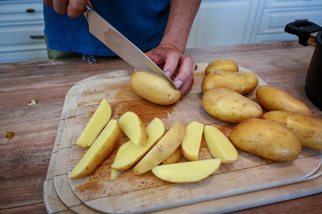 Cut potatoes into wedges.