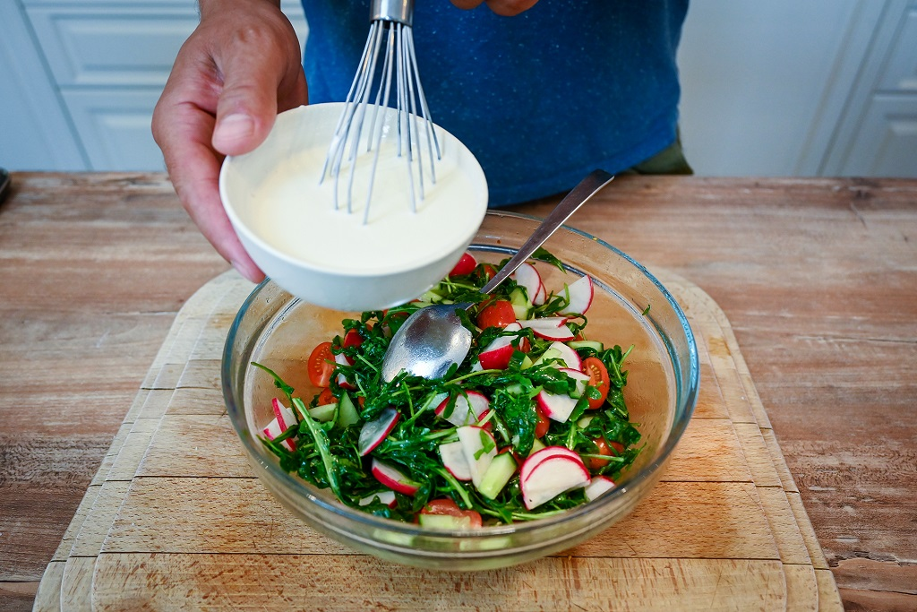 Add a dressing to make the salad better.