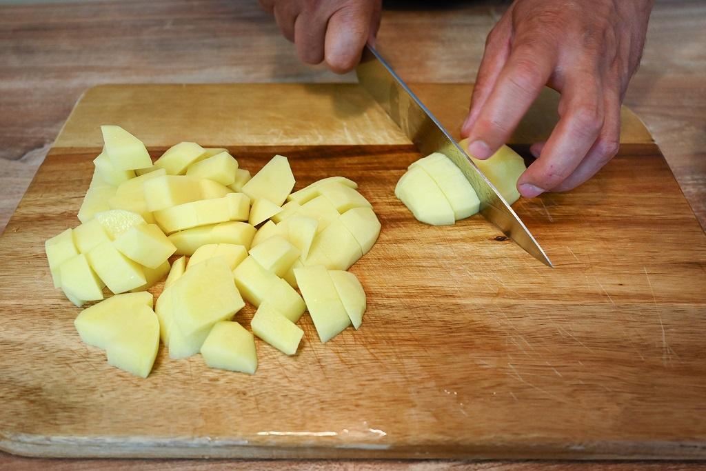 Dice the potatoes.