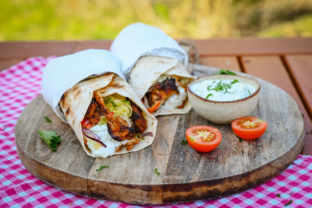 Chicken Gyros with vegetable salad and tzatziki sauce.