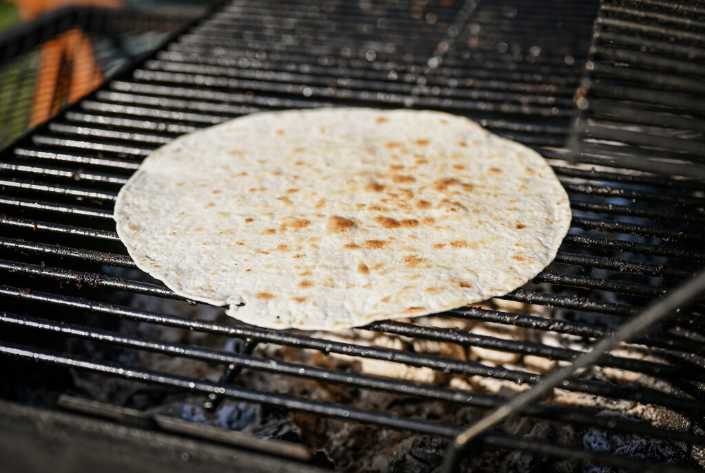 Heat up a Pita or Tortilla on the grill.