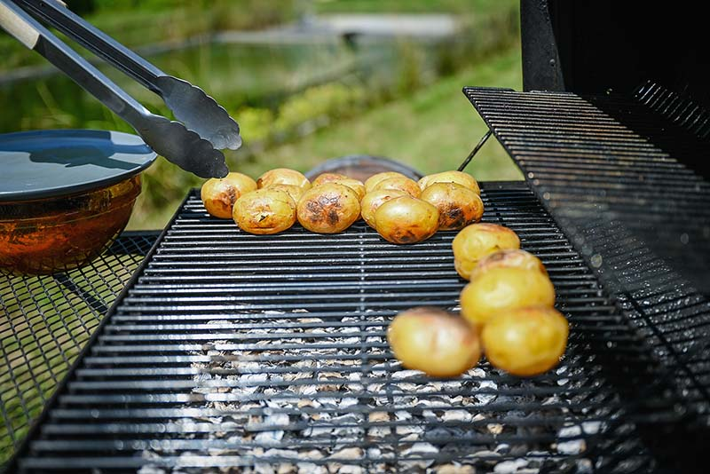 Potatoes are done, move them away from direct heat.