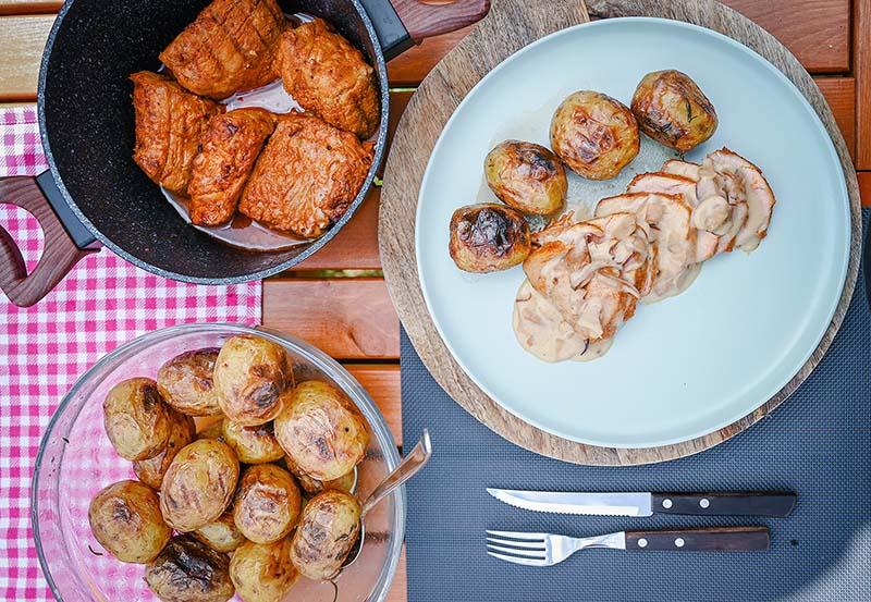 Grilled pork tenderloin with potatoes and mushroom sauce.